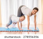 mother and daughter doing yoga... | Shutterstock . vector #278556356