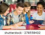 a group of teenagers sitting at ... | Shutterstock . vector #278558432