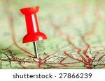 Red Pushpin On A Tourist Map...
