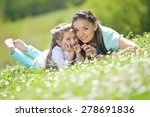 mother and daughter in the park | Shutterstock . vector #278691836