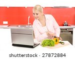 woman with laptop preparing food | Shutterstock . vector #27872884