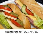 baguette sandwiches with lettuce, tomatoes, ham, cheese and mustard - stock photo