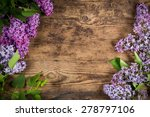 Bunch Of Lilac On Brown Wood...