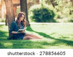 Girl Reading A Book In Park ...
