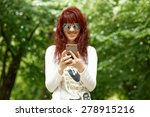 beautiful woman uses smartphone ... | Shutterstock . vector #278915216