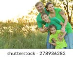 cheerful family in green shirts ... | Shutterstock . vector #278936282