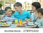 happy mother and children at... | Shutterstock . vector #278991032