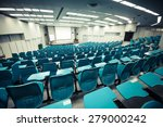 an empty large lecture room  ...