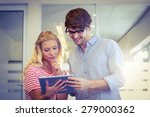 colleagues looking at tablet pc ... | Shutterstock . vector #279000362