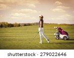 female golfer on fairway with... | Shutterstock . vector #279022646