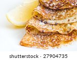 pancakes with sugar and lemon slice - stock photo