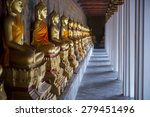 row of golden seated buddhas in ...