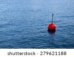Red Bouy On A Calm Lake...
