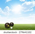 A Set Of Wooden Lawn Bowls Nex...