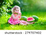 Child Eating Watermelon In The...