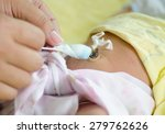close up cleaning umbilical... | Shutterstock . vector #279762626