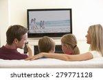 family watching widescreen tv...   Shutterstock . vector #279771128