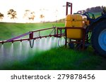 Tractor Spraying Wheat Field...