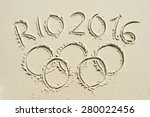 Small photo of RIO DE JANEIRO, BRAZIL - MARCH 20, 2015: Rio 2016 message with Olympic rings drawn in the sand on Ipanema Beach in anticipation of the city hosting the Summer Games.
