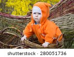 baby girl in hand made basket | Shutterstock . vector #280051736