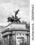 Small photo of Wellington Arch (or Constitution Arch) - triumphal arch located to south of Hyde Park. London, UK. Design by Decimus Burton, built between 1826 - 1830. Black and white.