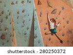 Sporty Little Girl Climbing...