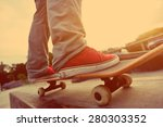 skateboarding legs at skatepark | Shutterstock . vector #280303352
