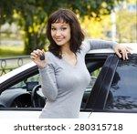 pretty girl showing the car key | Shutterstock . vector #280315718
