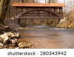 wooden bridge crossing stream