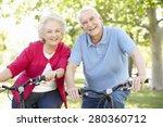 senior couple riding bikes | Shutterstock . vector #280360712