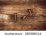 Old Nails Pierced Wooden Board