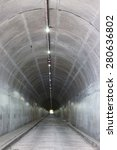 A Long Concrete Tunnel Leads...