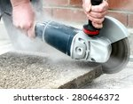 Industrial construction worker using a professional angle grinder. - stock photo
