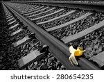 """Small photo of Banana peel on railway. """" Train Sabotage """" humoristic conceptual image."""