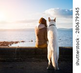 Stock photo young hipster girl with her pet dog at a seaside colorised image 280679345