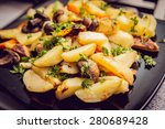 fried potatoes with mushrooms.... | Shutterstock . vector #280689428