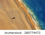 lonely boat on a beach with... | Shutterstock . vector #280774472