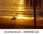 Horse Rider Silhouette At...