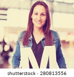 woman holding the m letter | Shutterstock . vector #280813556