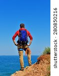 man with backpack on top of... | Shutterstock . vector #280850216