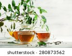 cups of green tea on table on