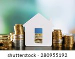 model of house with coins on... | Shutterstock . vector #280955192