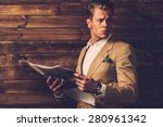 Stylish Man With Newspaper In...