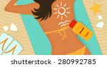 young girl sunbathes on a beach ...