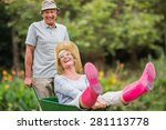 happy senior couple playing... | Shutterstock . vector #281113778