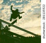 Skateboarder Silhouette Doing ...