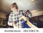 senior craftsman working with... | Shutterstock . vector #281148176