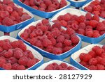 raspberries in containers on a French farmers market - stock photo