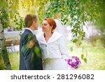 bride and groom in autumn park | Shutterstock . vector #281296082