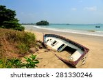 Old Yacht Stranded On A Beach...